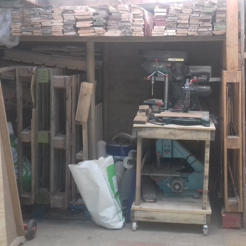 the old log store after being modified to store pallet wood planks