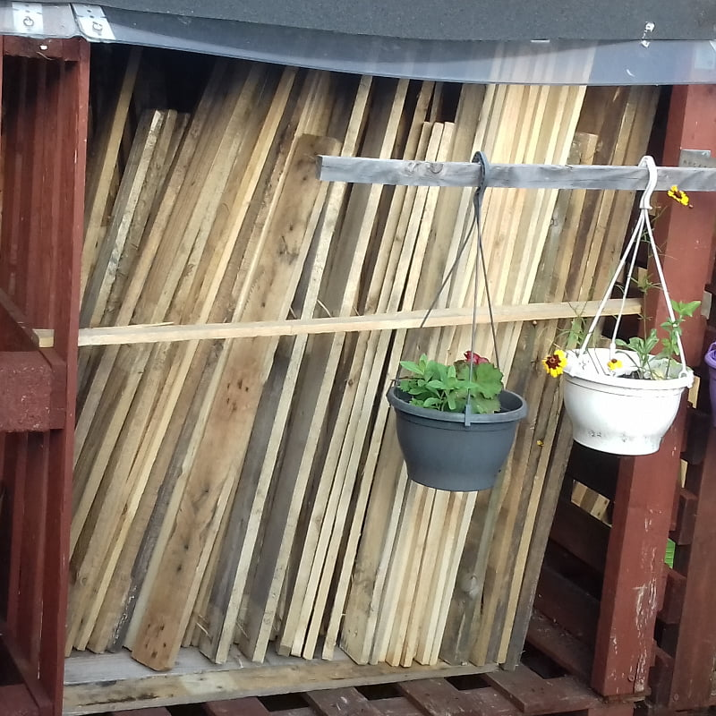 pallet wood planks stored in outside log stores