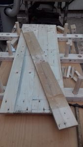 four pallet wood planks on the clamps ready for gluing together